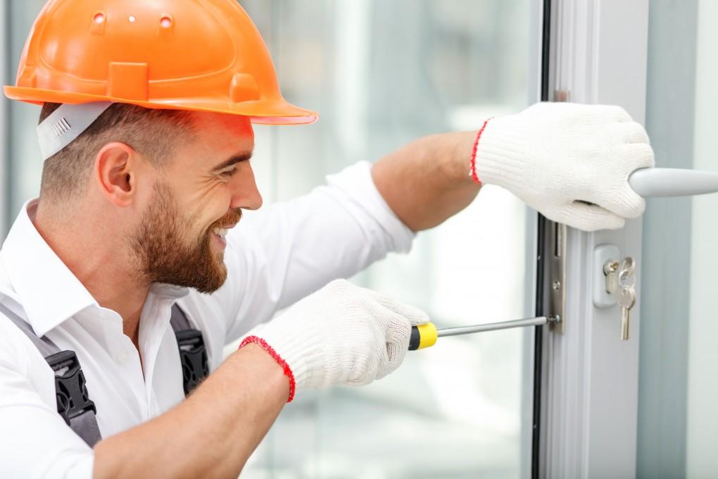 man working on commercial door